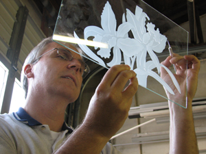 "Terry Vick checks etched glass. ""F-1"